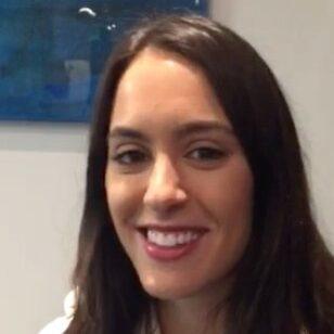 Brunette girl smiling after front tooth restoration